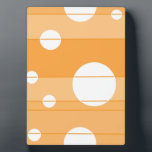 "Dots and Stripes in YellowOrange Plaque<br><div class=""desc"">This digitally created design consists of sections of orange divided by lines that cut through the circles of various sizes spaced throughout the design.</div>"