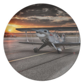 Double decker propeller plane on runway melamine plate