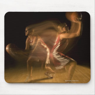Double exposure of woman playing basketball mouse pad