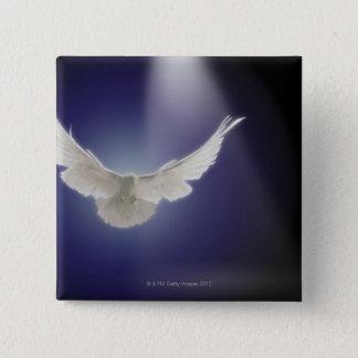 Dove flying through beam of light pinback button