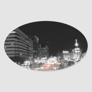 Downtown Baltimore Traffic at Night Oval Sticker