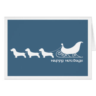 Doxies (Wirehaired) que tiran del trineo de Santa Felicitaciones