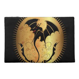 Dragón asombroso en oro y negro
