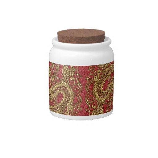 Dragón del oro en textura de cuero roja jarra para caramelo