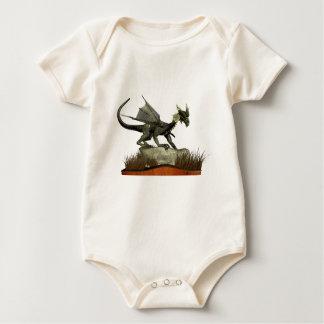 Dragón derecho en una roca body para bebé