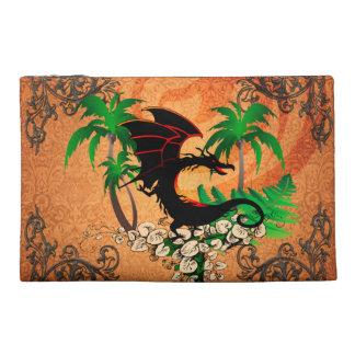 Dragón divertido con la palma y las flores