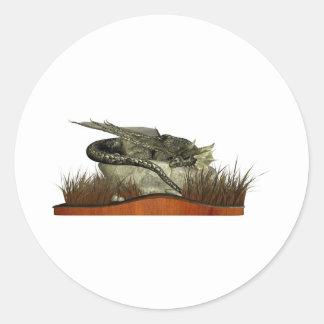 Dragón el dormir en una roca pegatinas redondas