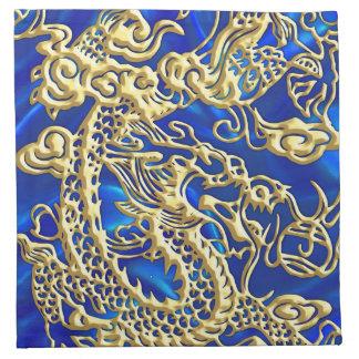 Dragón grabado en relieve del oro en el satén azul servilleta