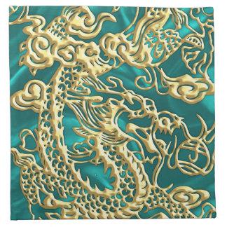 Dragón grabado en relieve del oro en el satén de servilleta