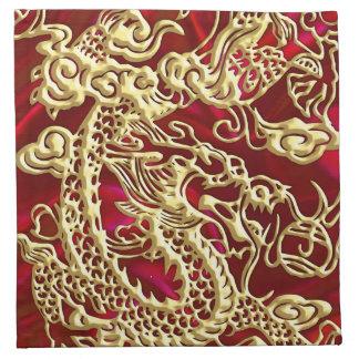 Dragón grabado en relieve del oro en el satén rojo servilleta de papel