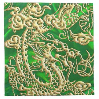 Dragón grabado en relieve del oro en el satén servilleta de papel