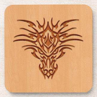 Dragon head engraved on wood effect beverage coaster