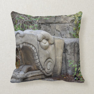 dragon head sculpture with plants pillow