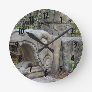 dragon head sculpture with plants round clock