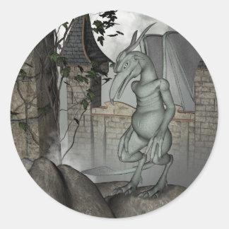 Dragon on a rock classic round sticker