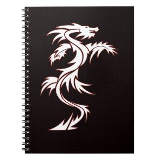 Dragón que brilla intensamente libreta