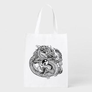 dragón que lleva a cabo el yin yang bolsas de la compra