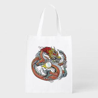 dragón que sostiene la perla bolsa de la compra