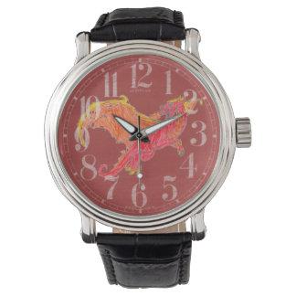 Dragón rojo con alas relojes