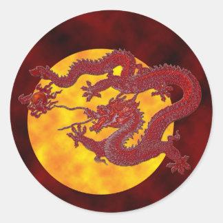 Dragón rojo de la cera pegatina redonda
