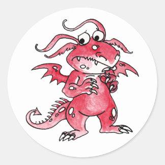Dragón rojo preocupante pegatina redonda