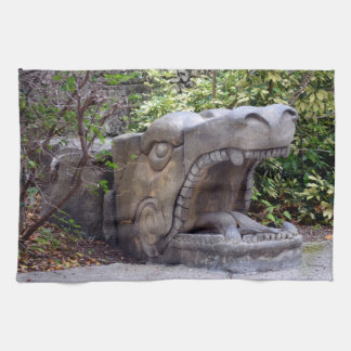 dragon statue mouth open stone towels