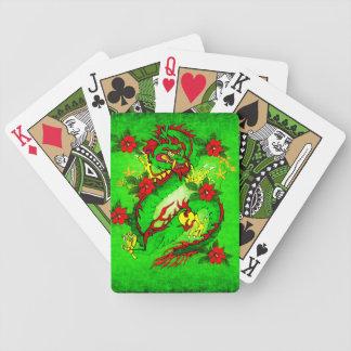 Dragón verde y flores rojas barajas