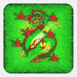 Dragón verde y flores rojas etiqueta