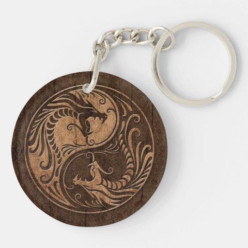 Dragones de Yin Yang con el efecto de madera del g Llaveros