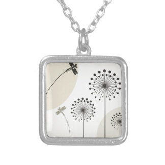 Dragonfly on a flower silver plated necklace