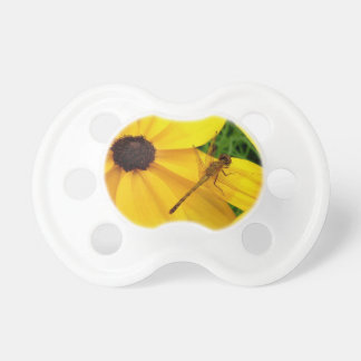 Dragonfly on yellow flower pacifier
