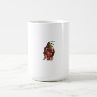 Dragonfruit held in fingers photo mug