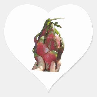 Dragonfruit held in fingers photo sticker