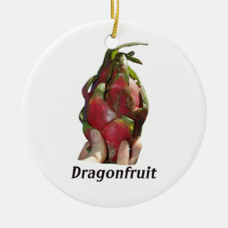 Dragonfruit held in fingers with text photo Pitaya Ornament