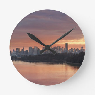 Dramatic Colorful sunset sky over Vancouver BC Round Clock