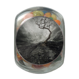 Dramatic sky over old lonely tree glass jar