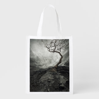 Dramatic sky over old lonely tree grocery bag