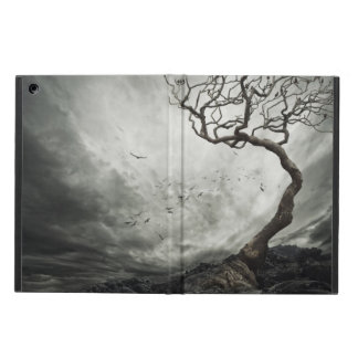 Dramatic sky over old lonely tree iPad air cases