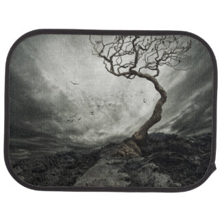 Dramatic sky over old lonely tree floor mat