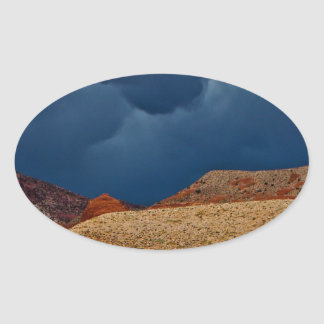 DRAMATIC STORM CLOUDS OVER HIGH DESERT OVAL STICKER