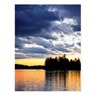 Dramatic sunset at lake postcard