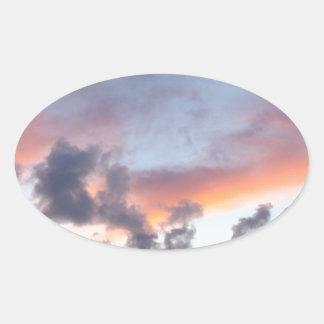 Dramatic sunset sky oval sticker