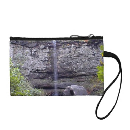 Dramatic waterfall flowing down the cliffs coin purses