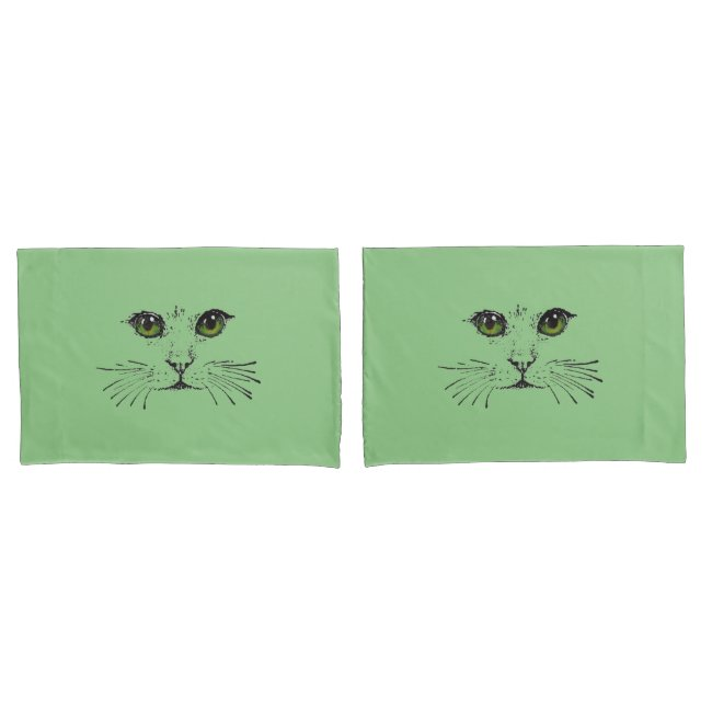 Drawing in Black of a Cat Face Bright Green Eyes