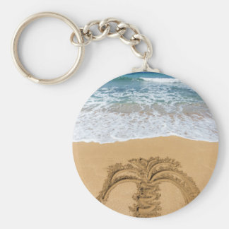 Drawing of palm tree on sandy beach keychain