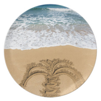 Drawing of palm tree on sandy beach plate