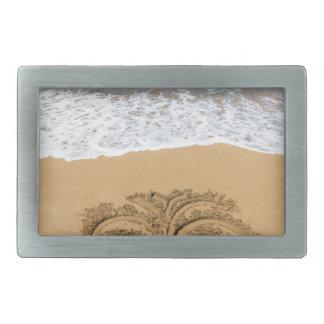 Drawing of palm tree on sandy beach rectangular belt buckle