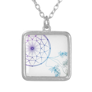 dream catcher on white background silver plated necklace