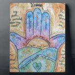"Dream Hamsa Plaque<br><div class=""desc"">Many contemporary Judaica artists use symbolism from middle eastern culture, combining old traditions with modern art, while adding elements from their own imaginations. It is my intention to present a series of hamsas that create a bridge between our humanness and the divine. In my paintings, the classic eye is replaced...</div>"