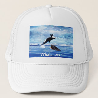Dreamy Whales enjoying the ocean Trucker Hat